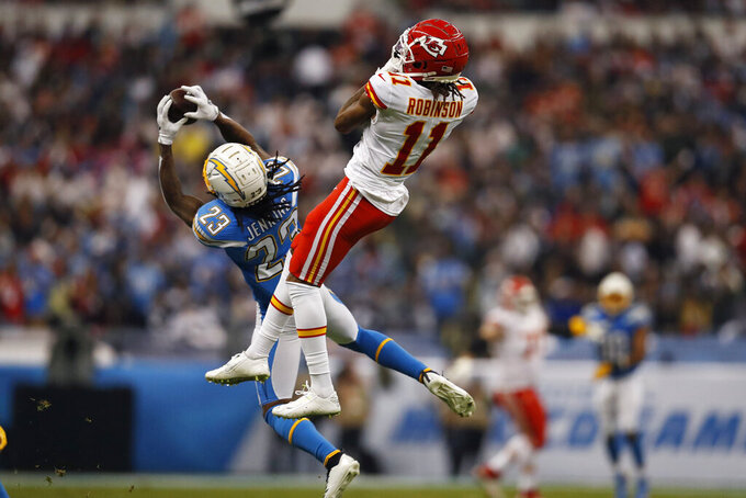 Los Angeles Chargers strong safety Rayshawn Jenkins (23) intercepts a pass intended for Kansas City Chiefs wide receiver Demarcus Robinson (11) during the first half of an NFL football game Monday, Nov. 18, 2019, in Mexico City. (AP Photo/Eduardo Verdugo)