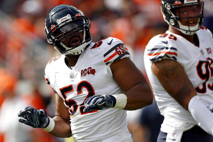 Chicago Bears outside linebacker Khalil Mack (52) celebrates his sack against the Denver Broncos during the first half of an NFL football game, Sunday, Sept. 15, 2019, in Denver. (AP Photo/David Zalubowski)