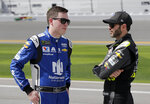 In this Sunday, Feb. 11, 2018, file photo, Alex Bowman, left, and Jimmie Johnson talk on pit road before qualifying for the NASCAR Daytona 500 auto race at Daytona International Speedway, in Daytona Beach, Fla. The most coveted seat in NASCAR went to Alex Bowman in a Hendrick Motorsports lineup shuffle to replace seven-time champion Jimmie Johnson in the iconic No. 48 Chevrolet. Bowman and crew chief Greg Ives will move from the No. 88 into Johnson's ride at the end of the season. The swap announced Tuesday, Oct. 6, 2020, makes Bowman just the second driver of the team created in 2001 specifically for Johnson. (AP Photo/Terry Renna, File)