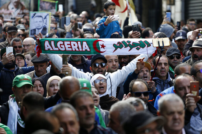 Protesters take to the streets in the capital Algiers to reject the presidential elections and protest against the government, in Algeria, Friday, Dec. 27, 2019. (AP Photo/Toufik Doudou)