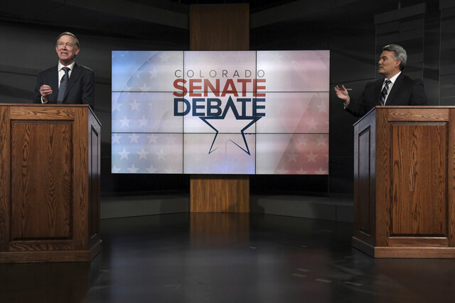FILE - In this Oct. 9, 2020, file photo Republican U.S. Sen. Cory Gardner, right, and Democratic former Colorado Gov. John Hickenlooper participate in a debate in Denver. Gardner is poised to be one of the votes that places President Donald Trump's nominee Amy Coney Barrett on the Supreme Court just before the election. (Hyoung Chang/The Denver Post via AP, Pool, File)
