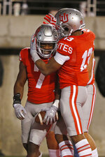 Utah's Devonta'e Henry-Cole (7) celebrates with Donte Banton (13) after scoring against UCLA during the second half of an NCAA college football game Saturday, Nov. 16, 2019, in Salt Lake City. (AP Photo/Rick Bowmer)