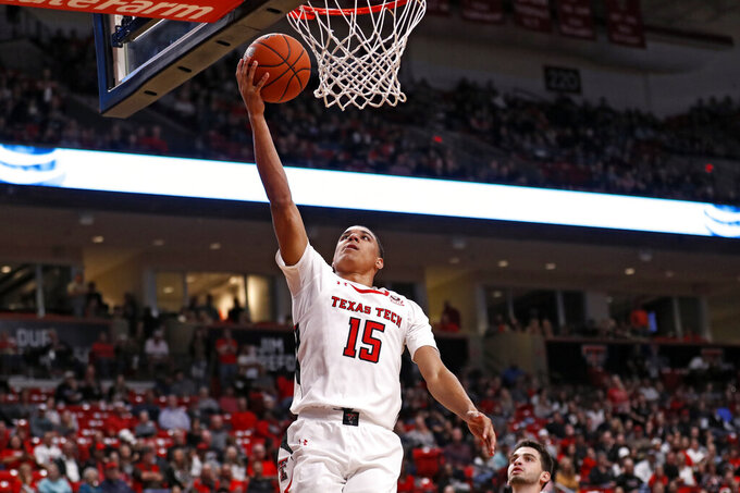 Texas Tech's Kevin McCullar (15) lays up the ball during the second half of an NCAA college basketball game against Eastern Illinois, Tuesday, Nov. 5, 2019, in Lubbock, Texas. (AP Photo/Brad Tollefson)