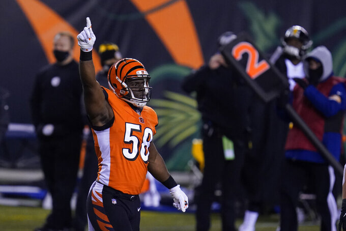 Cincinnati Bengals' Carl Lawson (58) reacts after sacking Pittsburgh Steelers quarterback Ben Roethlisberger during the first half of an NFL football game, Monday, Dec. 21, 2020, in Cincinnati. (AP Photo/Michael Conroy)