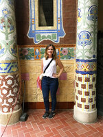 This Oct. 14, 2019 photo shows Associated Press writer  Courtney Bonnell posing in front of the mosaic-encrusted terrace of architect Lluís Domènech I Montaner's Palau de la Música Catalana in Barcelona, Spain. f you're taking a solo trip for the first time, a European city like Barcelona is a good place to start. The city is dynamic, the streets and cafes are always packed, it's safe to walk around at night and people mostly speak English. (Courtney Bonnell via AP)