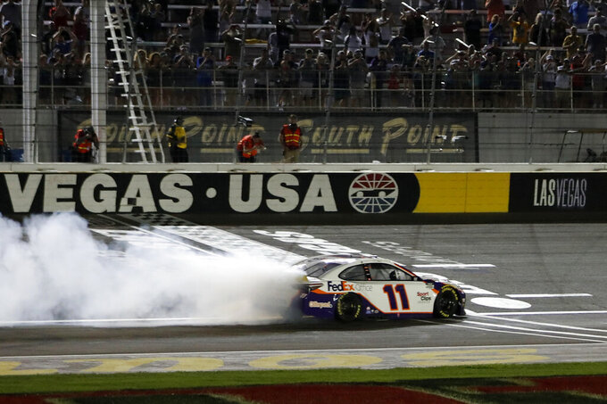 NASCAR Cup Series driver Denny Hamlin (11) performs a burnout after winning a NASCAR Cup Series auto race at the Las Vegas Motor Speedway Sunday, Sept. 26, 2021, in Las Vegas. (AP Photo/Steve Marcus)