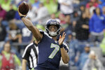 Seattle Seahawks quarterback Geno Smith passes during the first half of an NFL football preseason game against the Oakland Raiders, Thursday, Aug. 29, 2019, in Seattle. (AP Photo/Elaine Thompson)
