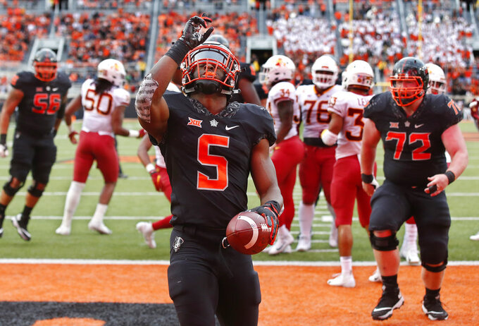 Oklahoma State running back Justice Hill (5) celebrates a touchdown in the second half of an NCAA college football game against Iowa State in Stillwater, Okla., Saturday, Oct. 6, 2018. (AP Photo/Sue Ogrocki)