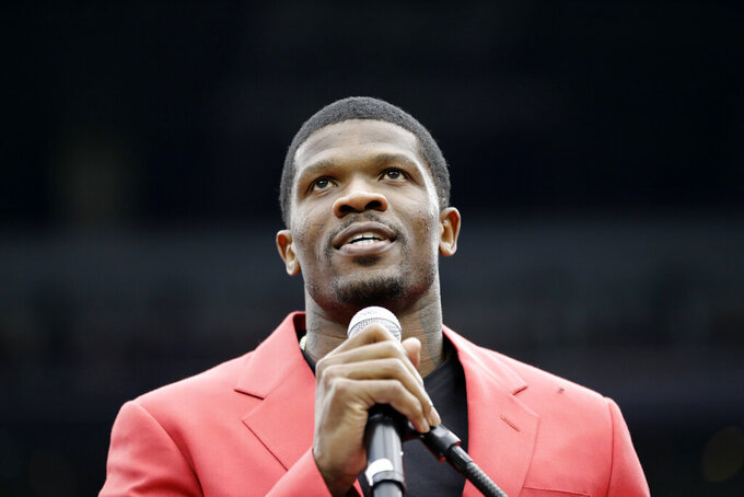 FILE - Former Houston Texans receiver Andre Johnson speaks after being inducted into the Texans Ring of Honor during halftime of an NFL football game against the Arizona Cardinals in Houston, in this Sunday, Nov. 19, 2017, file photo. Ten first-year eligible players, including receiver Andre Johnson, are among 122 nominees for the 2022 class of the Pro Football Hall of Fame, announced Wednesday, Sept. 22, 2021.(AP Photo/David J. Phillip, File)