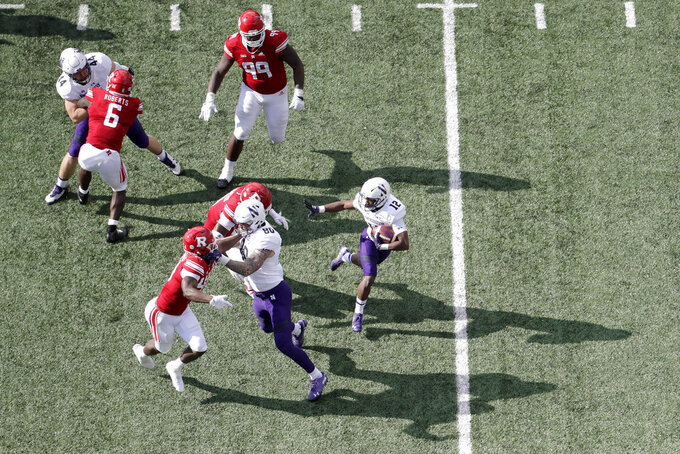 Northwestern wide receiver JJ Jefferson (12) runs with the ball against Rutgers during the second half of an NCAA college football game, Saturday, Oct. 20, 2018, in Piscataway, N.J. Northwestern won 18-15. (AP Photo/Julio Cortez)