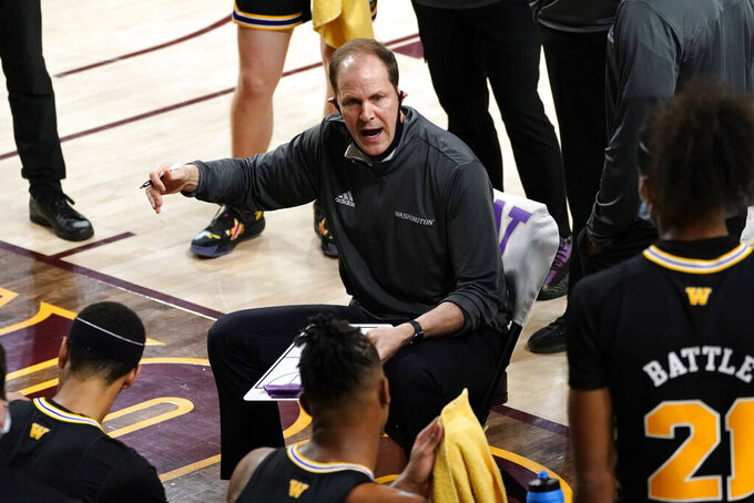 Washington coach Mike Hopkins talks to the team during the first half of an NCAA college basketball game against Arizona State, Tuesday, Feb. 23, 2021, in Tempe, Ariz. (AP Photo/Rick Scuteri)