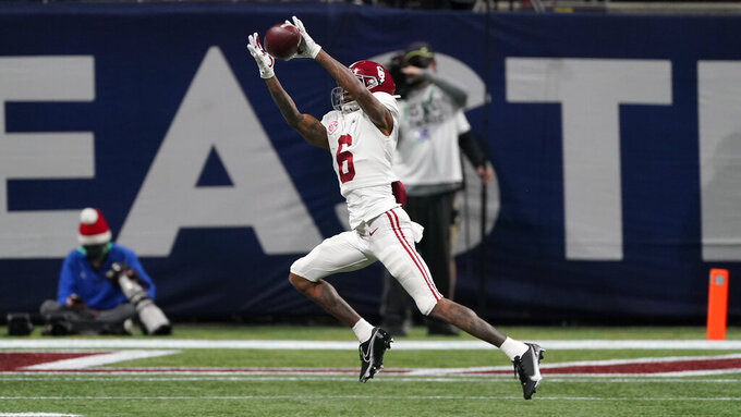 Alabama wide receiver DeVonta Smith (6) makes a catch for a touchdown against Florida during the first half of the Southeastern Conference championship NCAA college football game, Saturday, Dec. 19, 2020, in Atlanta. (AP Photo/John Bazemore)