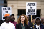 File-In this Oct. 1, 2019,  file photograph, the father of Elijah McClain, LaWayne Mosley, left, and mother, Sheneen McClain, right, flank the family's lawyer, Mari Newman, during a protest outside city hall in Aurora, Colo. Elijah McClain died after being stopped by three police officers while walking in the east Denver suburb of Aurora. (Philip B. Poston/Sentinel Colorado via AP, File)
