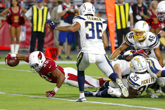 Arizona Cardinals running back Wes Hills (49) scores a touchdown as Los Angeles Chargers defensive back Roderic Teamer (36) defends during the second half of an NFL preseason football game, Thursday, Aug. 8, 2019, in Glendale, Ariz. (AP Photo/Rick Scuteri)