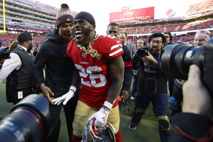 San Francisco 49ers running back Tevin Coleman (26) celebrates after the 49ers beat the Minnesota Vikings 27-10 in an NFL divisional playoff football game, Saturday, Jan. 11, 2020, in Santa Clara, Calif. (AP Photo/Marcio Jose Sanchez)