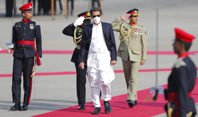 Pakistan's Prime Minister Imran Khan inspects a Guard of Honor upon his arrival in Colombo, Sri Lanka, Tuesday, Feb. 23, 2021. Khan is in Sri Lanka for a two day official visit. (AP Photo/Eranga Jayawardena)