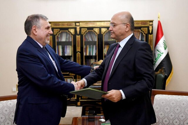 Iraqi President Barham Salih, right, instructs newly appointed Prime Minister Mohammed Allawi in Baghdad, Iraq, Saturday, Feb. 1, 2020. Former communications minister Mohammed Allawi was named prime minister-designate by rival Iraqi factions Saturday after weeks of political deadlock. (Iraqi Presidency Media Office, via AP)