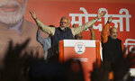 Indian Prime Minister Narendra Modi addresses party supporters, standing next to his Bharatiya Janata Party (BJP) President Amit Shah at their headquarters in New Delhi, India, Thursday, May 23, 2019. Modi's Hindu nationalist party claimed it won reelection with a commanding lead in Thursday's vote count, while the head of the main opposition party conceded a personal defeat that signaled the end of an era for modern India's main political dynasty. (AP Photo/Manish Swarup)