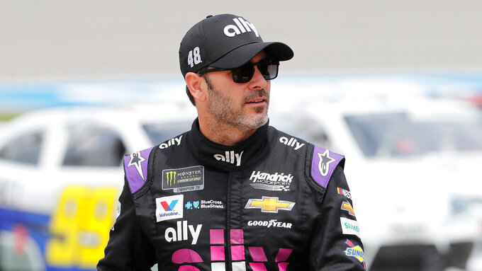 Jimmie Johnson walks in the pit area before qualifying for the NASCAR cup series race at Michigan International Speedway, Saturday, June 8, 2019, in Brooklyn, Mich. (AP Photo/Carlos Osorio)