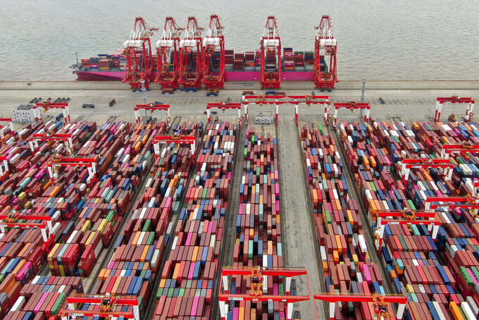 FILE - In this July 10, 2021, file photo, the Yangshan container port is seen in an aerial view in Shanghai, China. China has applied to join an 11-nation Asia-Pacific free trade group in an effort to increase its influence over international policies. (Chinatopix via AP, File)