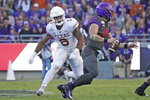 FILE - In this Oct. 26, 2019, file photo, Texas linebacker Juwan Mitchell (6) pursues TCU quarterback Max Duggan during the second half of an NCAA college football game in Fort Worth, Texas. The two teams meet again this week. TCU won only six of its last 39 meetings against Texas when they were still together in the old Southwest Conference through the 1995 season. Coach Gary Patterson and TCU have matched that win total in eight games since joining the Longhorns in the Big 12 less than a decade ago. (AP Photo/Louis DeLuca, File)