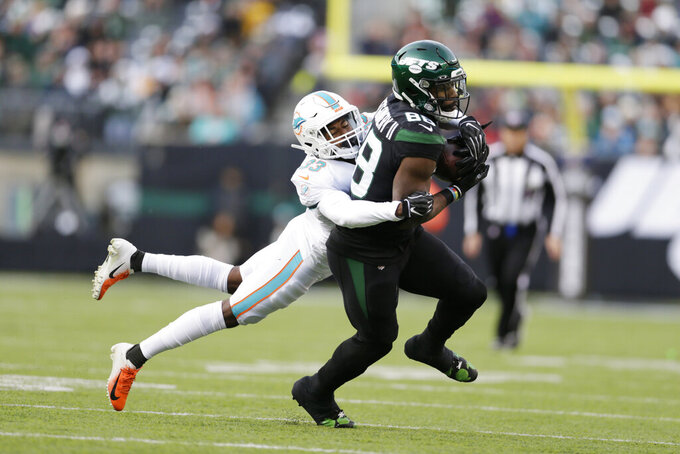 Miami Dolphins cornerback Jomal Wiltz (33) stops New York Jets running back Ty Montgomery (88) during the second half of an NFL football game, Sunday, Dec. 8, 2019, in East Rutherford, N.J. (AP Photo/Adam Hunger)
