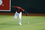 Arizona Diamondbacks center fielder Starling Marte is unable to make a catch on a single hit by Los Angeles Dodgers' Max Muncy during the fifth inning of a baseball game Sunday, Aug. 2, 2020, in Phoenix. (AP Photo/Ross D. Franklin)
