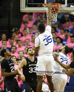 Seton Hall center Romaro Gill (35) dunks over Butler guard Henry Baddley (20) and forward Bryce Golden (33) during the first half of an NCAA college basketball game Wednesday, Feb. 19, 2020, in Newark, N.J. Seton Hall forward Sandro Mamukelashvili is at right. (AP Photo/Kathy Willens)