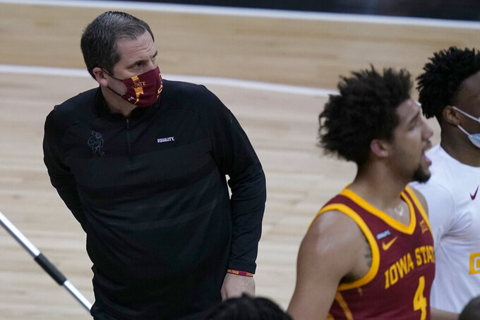 Iowa State coach Steve Prohm waits for his team to gather during a timeout in the first half of an NCAA college basketball game against Oklahoma in the first round of the Big 12 men's tournament in Kansas City, Mo., Wednesday, March 10, 2021. (AP Photo/Orlin Wagner)