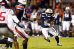FILE - In this Nov. 2, 2019, file photo, Auburn running back Shaun Shivers (8) carries the ball during the first half of an NCAA college football game against Mississippi in Auburn, Ala. The Auburn Tigers once seemed virtual locks to have at least one 1,000-yard rusher every season. (AP Photo/Butch Dill, File)