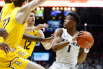 Xavier's Paul Scruggs (1) looks to pass against Lipscomb's Carson Cary (12) during the first half of an NCAA college basketball game, Saturday, Nov. 30, 2019, in Cincinnati. (AP Photo/John Minchillo)