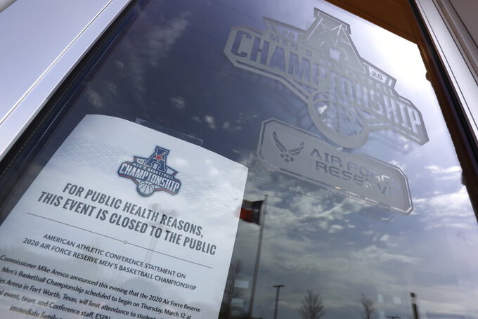 A sign posted at an entrance to Dickies Arena where the NCAA college basketball games in the American Athletic Conference tournament were to be played Thursday, March 12, 2020 in Fort Worth, Texas. The tournament was canceled due to coronavirus concerns. (AP Photo/Richard Rodriguez)