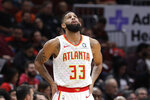 Atlanta Hawks guard/forward Allen Crabbe looks at the scoreboard during the first half of an NBA basketball game against the Chicago Bulls, Saturday, Dec. 28, 2019, in Chicago. (AP Photo/Nam Y. Huh)