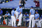Kansas City Royals left fielder Alex Gordon (4) high-fives teammates before a baseball game against the Detroit Tigers at Kauffman Stadium in Kansas City, Mo., Saturday, Sept. 26, 2020. (AP Photo/Orlin Wagner)