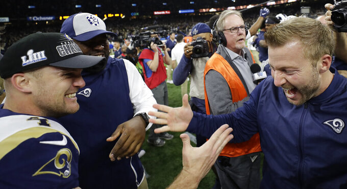 Los Angeles Rams head coach Sean McVay celebrates with Greg Zuerlein after a game-winning field goal during overtime of the NFL football NFC championship game against the New Orleans Saints, Sunday, Jan. 20, 2019, in New Orleans. The Rams won 26-23. (AP Photo/David J. Phillip)