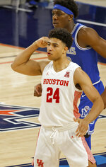 Houston guard Quentin Grimes (24) reacts after making a 3-point shot as Memphis center Malcolm Dandridge (23) looks on during the second half of an NCAA college basketball game in the semifinal round of the American Athletic Conference men's tournament Saturday, March 13, 2021, in Fort Worth, Texas. (AP Photo/Ron Jenkins)