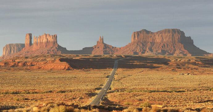 This Oct. 25, 2018, file photo, shows Monument Valley, Utah. A federal appeals court has upheld a ruling that found voting districts in a Utah county were racially gerrymandered and violated the rights of Navajo voters. The 10th Circuit Court of Appeals in Denver handed down the opinion Tuesday, July 16, 2019, in the case that resulted in the election of the first majority-Navajo commission in San Juan County, which overlaps with the Navajo Nation. (AP Photo/Rick Bowmer)