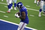 New York Giants offensive tackle Andrew Thomas (78) catches a pass for a two-point conversion in the second half of an NFL football game against the Dallas Cowboys in Arlington, Texas, Sunday, Oct. 11, 2020. (AP Photo/Michael Ainsworth)