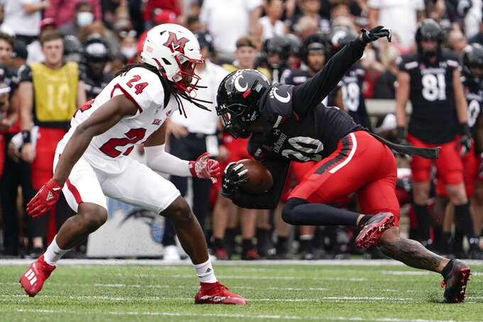 Cincinnati wide receiver Jadon Thompson (20) runs during the first half of an NCAA college football game against Miami (Ohio), Saturday, Sept. 4, 2021, in Cincinnati. (AP Photo/Jeff Dean)