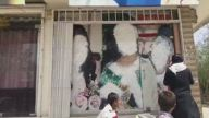 Women's faces erased from murals in Afghanistan