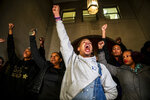 Christian Carter, of Pittsburgh's East Liberty neighborhood, left, leads a chant with other supporters of Antwon Rose II after they learned a not guilty verdict in the homicide trial of former East Pittsburgh police Officer Michael Rosfeld, Friday, March 22, 2019, at the Allegheny County Courthouse in downtown Pittsburgh, Pa. A jury acquitted Rosfeld, a former police officer Friday in the fatal shooting of Antwon Rose II, an unarmed teenager as he was fleeing a high-stakes traffic stop outside Pittsburgh, a confrontation that was captured on video and led to weeks of unrest. (Michael M. Santiago/Pittsburgh Post-Gazette via AP)