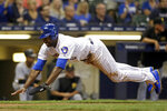 Milwaukee Brewers' Lorenzo Cain slides in safely at home to score a run on a single by Mike Moustakas during the first inning of the team's baseball game against the Pittsburgh Pirates on Friday, Sept. 20, 2019, in Milwaukee. (AP Photo/Aaron Gash)