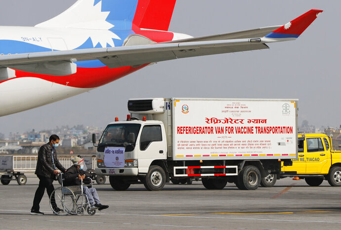 A van stands parked waiting to transport AstraZeneca/Oxford University vaccines, manufactured under license by Serum Institute of India, at Tribhuwan International Airport in Kathmandu, Nepal, Thursday, Jan. 21, 2021. India sent 1 million doses of a coronavirus vaccine to Nepal on Thursday, a gift that is likely to help repair strained ties between the two neighbors. (AP Photo/Niranjan Shrestha)