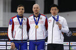 First-place Pavel Kulizhnikov, center, of Russia, shares the podium with second-place Ruslan Murashov, left, of Russia, and third-place Tatsuya Shinhama, of Japan, following the men's 500 meters during the world single distances speedskating championships Friday, Feb. 14, 2020, in Kearns, Utah. (AP Photo/Rick Bowmer)