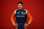 FILE - In this Feb. 10, 2020, file photo, IndyCar driver Scott Dixon poses for photos during IndyCar Media Day in Austin, Texas. The IndyCar season starts with the Grand Prix of St. Petersburg on Sunday, March 15, 2020. (AP Photo/Eric Gay, File)