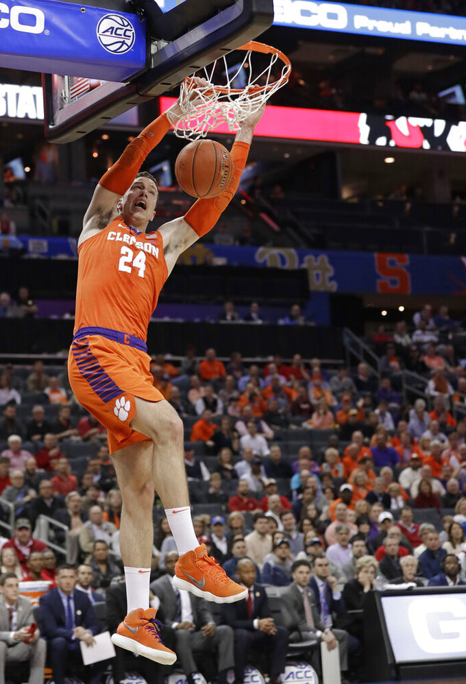 Clemson's David Skara (24) dunks against North Carolina State during the first half of an NCAA college basketball game in the Atlantic Coast Conference tournament in Charlotte, N.C., Wednesday, March 13, 2019. (AP Photo/Chuck Burton)