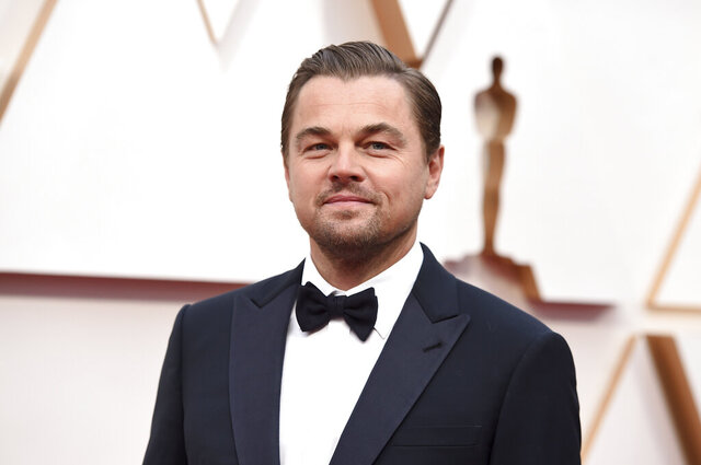 FILE - In this Feb. 9, 2020, file photo, Leonardo DiCaprio arrives at the Oscars in Los Angeles. DiCaprio is helping to launch the $12 million America's Food Fund aimed at helping low-income families, the elderly and those whose jobs have been disrupted by the coronavirus pandemic. Among those teaming up for the launch are philanthropist Laurene Powell Jobs, Apple and the Ford Foundation. (Photo by Jordan Strauss/Invision/AP, File)