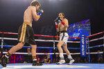 Nico Ali Walsh, right, faces Jordan Weeks during a middleweight boxing bout Saturday, Aug. 14, 2021, near Tulsa, Okla. (Brett Rojo/Tulsa World via AP)