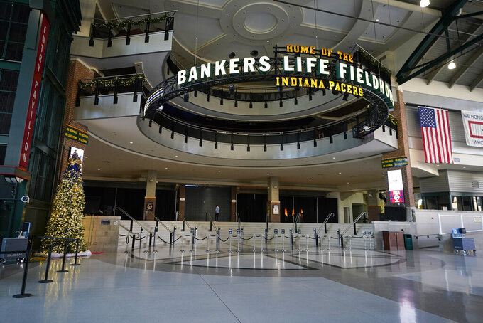 The lobby of Bankers Life FIeldhouse is empty before a scheduled NCAA college basketball game between Baylor and Gonzaga, Saturday, Dec. 5, 2020, in Indianapolis. The game was cancelled due to COVID. (AP Photo/Darron Cummings)