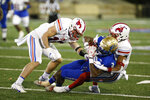 Tulsa wide receiver Keylon Stokes (2) is brought down by SMU defenders after a catch during the second half of an NCAA college football game in Tulsa, Okla., Saturday, Nov. 14, 2020. (AP Photo/Joey Johnson)